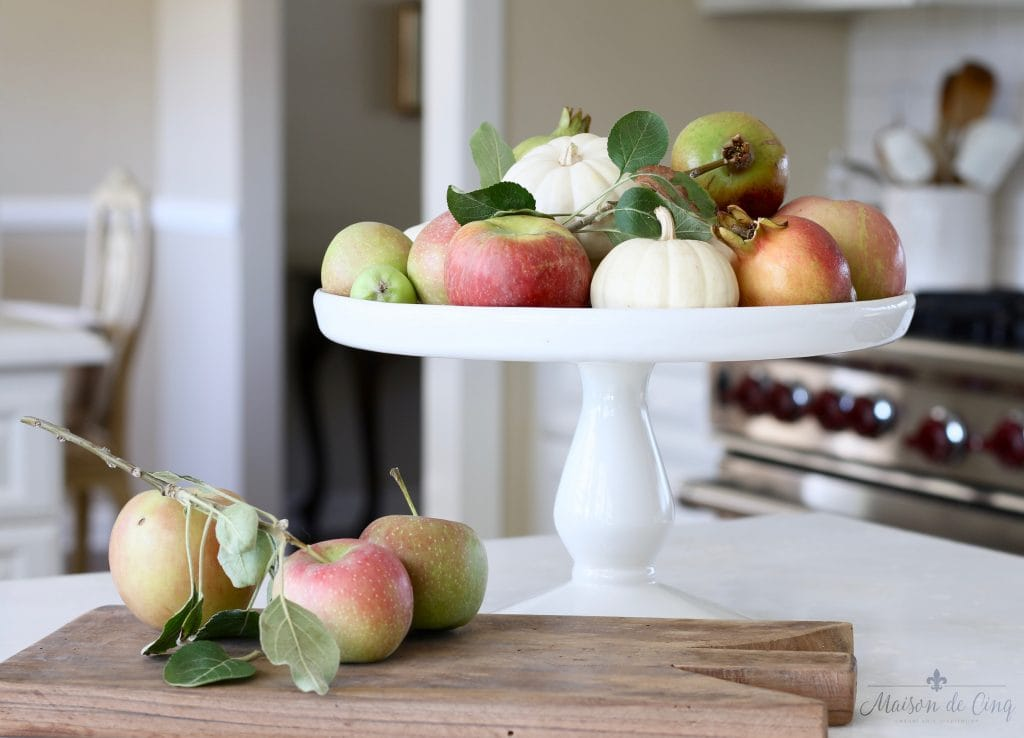 vintage french bread boards display kitchen white apples pumpkins cake plate fall display