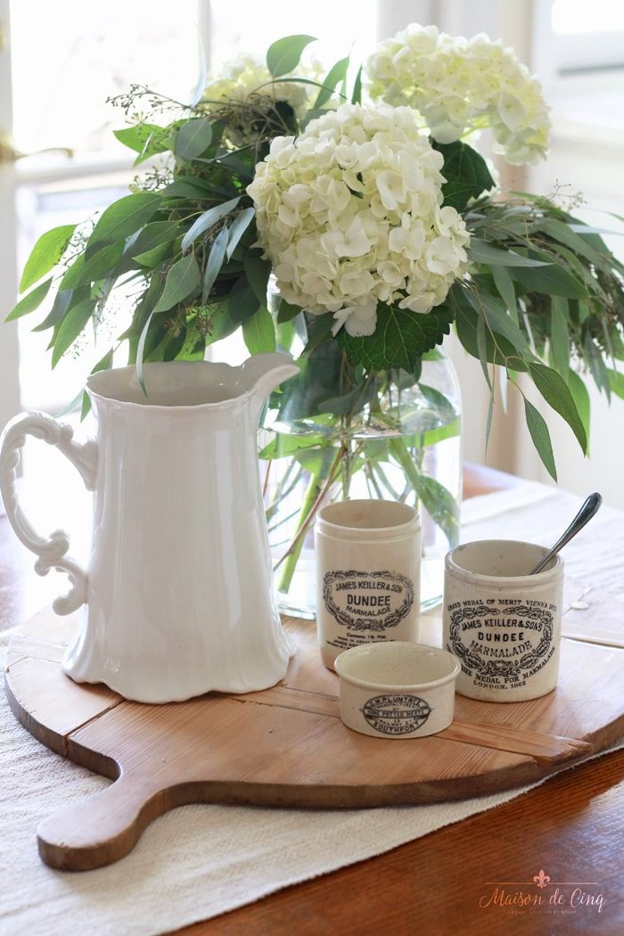 decorating with white hydrangeas French farmhouse style with vintage bread board and ironstone pitcher