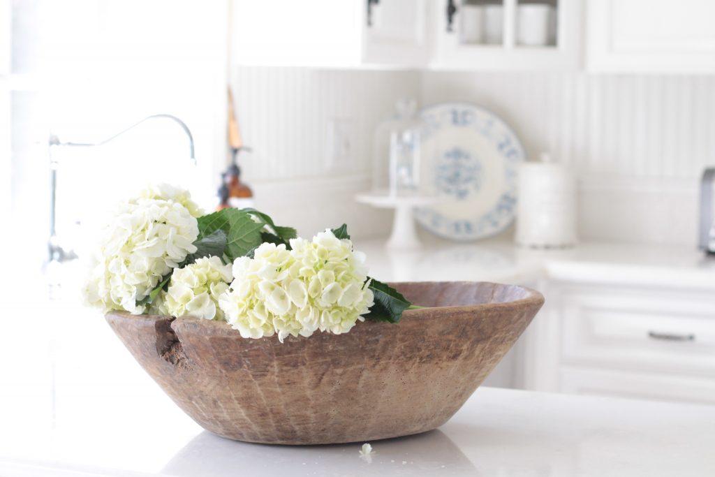 white hydrangeas vintage dough bowl white kitchen farmhouse style