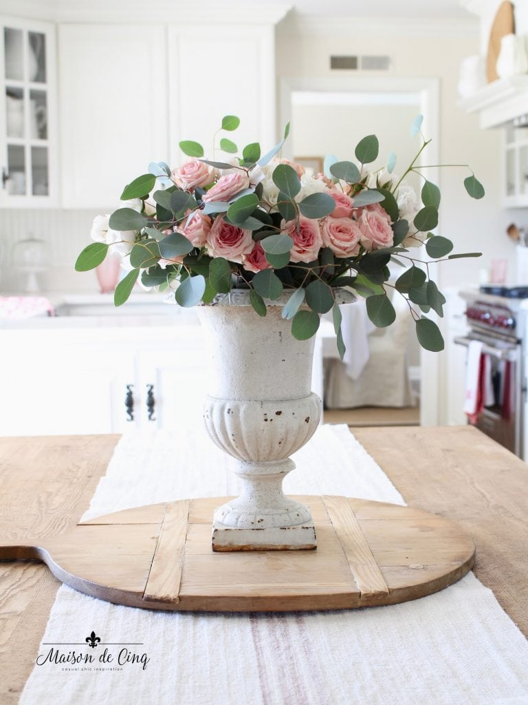French vintage bread board in white farmhouse kitchen with pink roses in gorgeous French urn