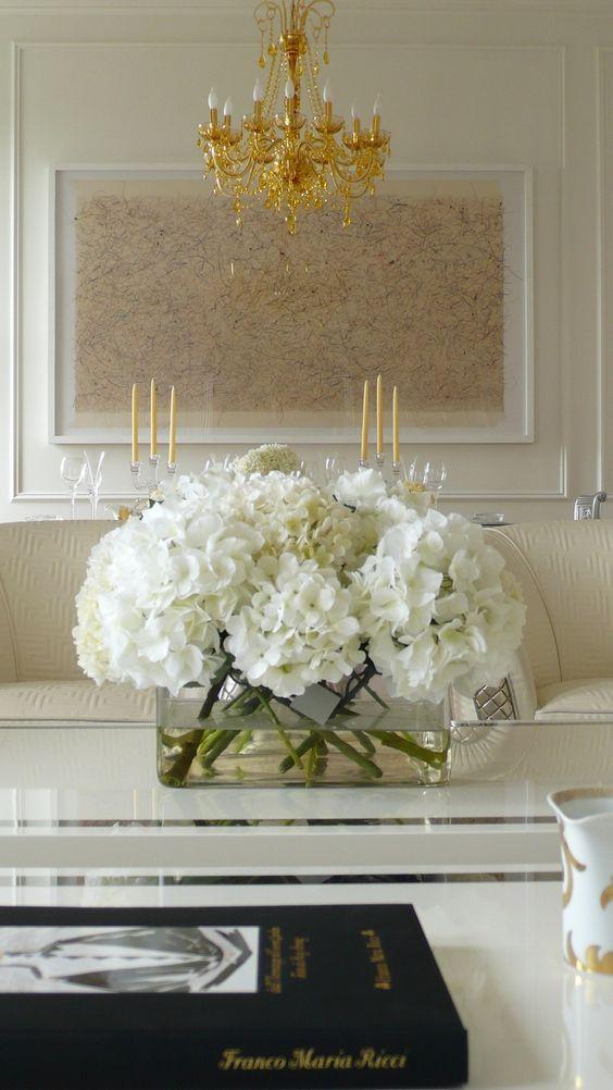 white hydrangeas modern glass vase neutral living room