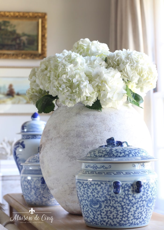 gorgeous white hydrangeas in antique olive jar with ginger jars French country farmhouse style decor