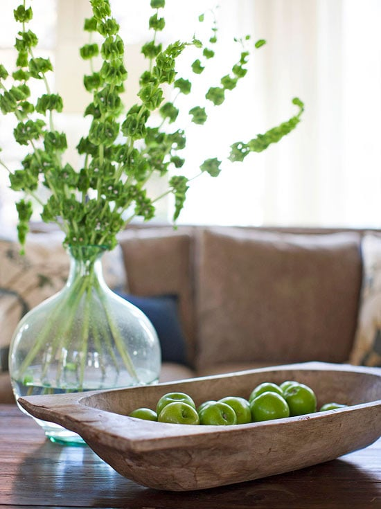 dough bowls filled with apples bottle with greens chic coffee table styling