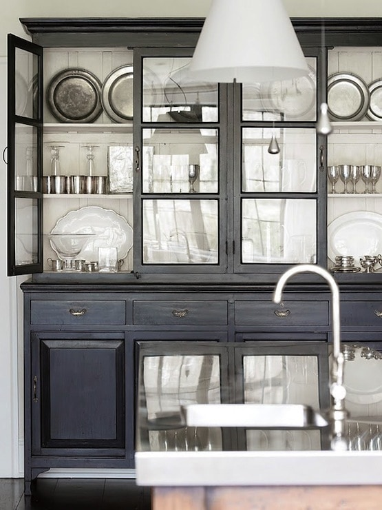 decorating with pewter plates displayed glass front cabinet dining room