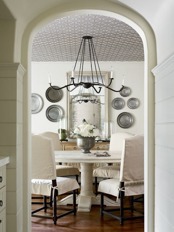 decorating with pewter plates wall display dining room