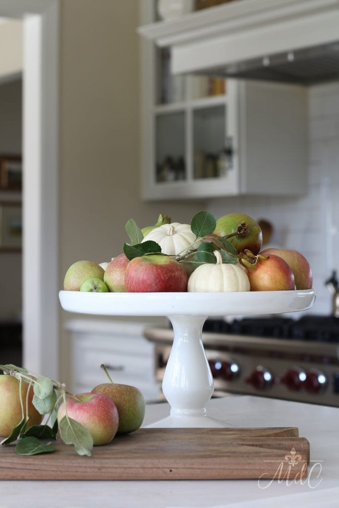 warm and cozy fall home tour apples pumpkins pomegranates white kitchen fall decor