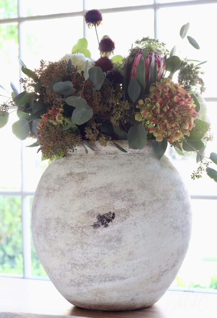 warm and cozy fall home tour gorgeous fall arrangement with warm color foliage
