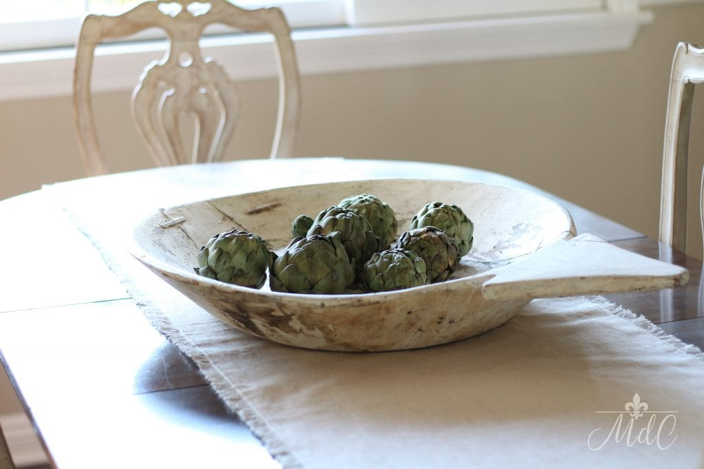 warm and cozy fall home tour antique bowl with artichokes fall inspiration