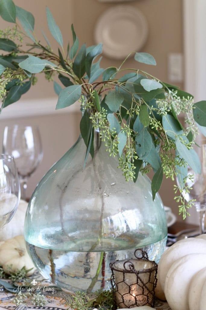 elegant fall tablescape demijohn with eucalyptus chicken wire candleholder