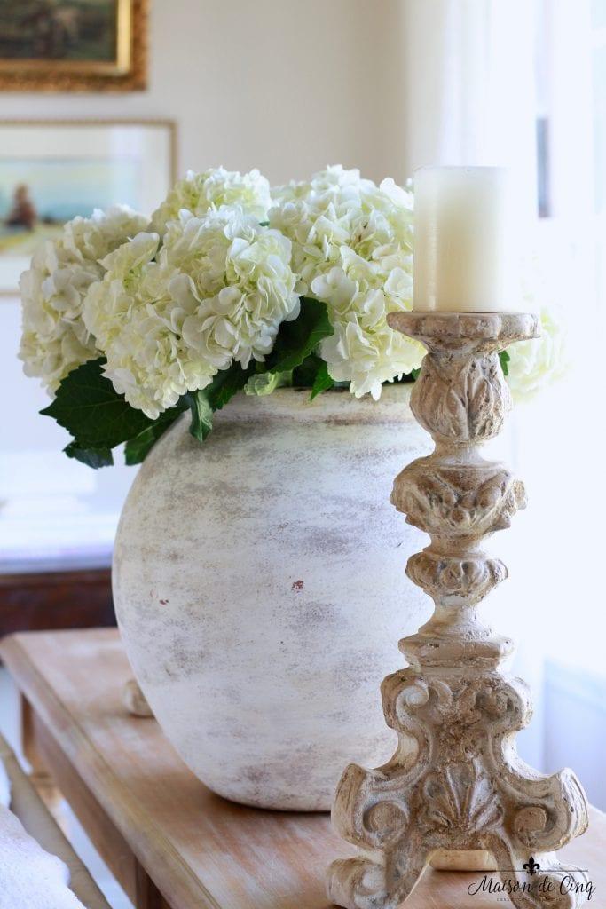 white hydrangeas large stone vase candleholder gorgeous french style vignette