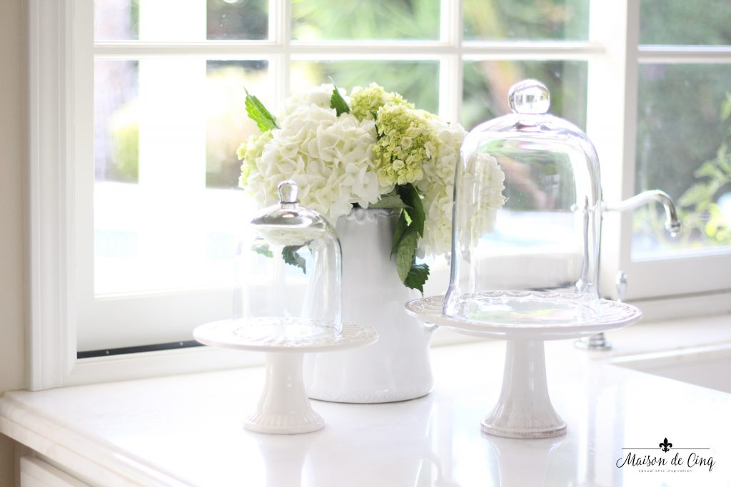 white hydrangeas grouping farmhouse kitchen counter cloche cake stand white pitcher