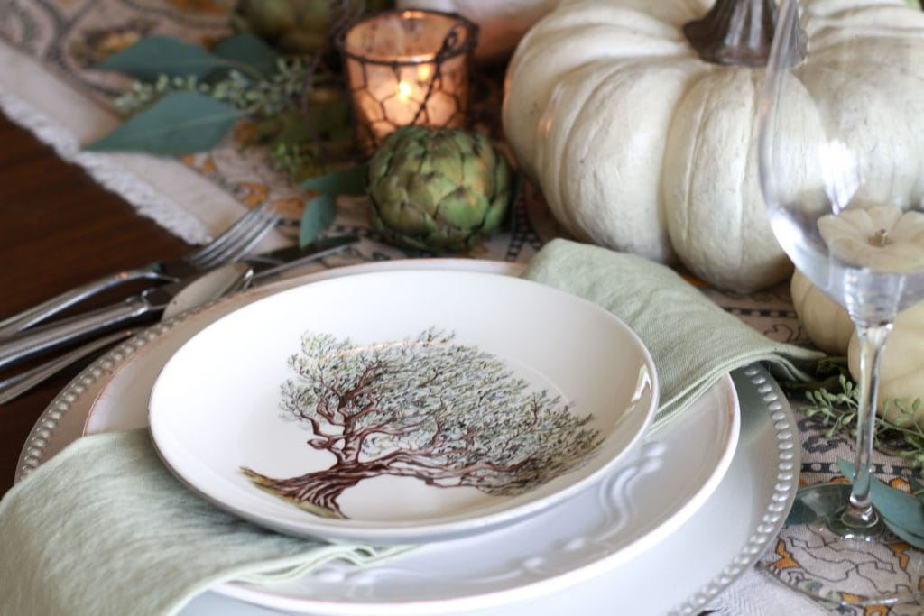 elegant fall tablescape with williams sonoma plates white pumpkins and artichokes