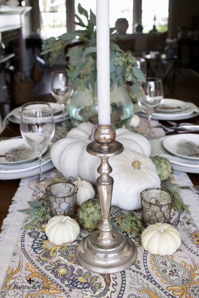 elegant fall tablescape silver candleholders white pumpkins artichokes