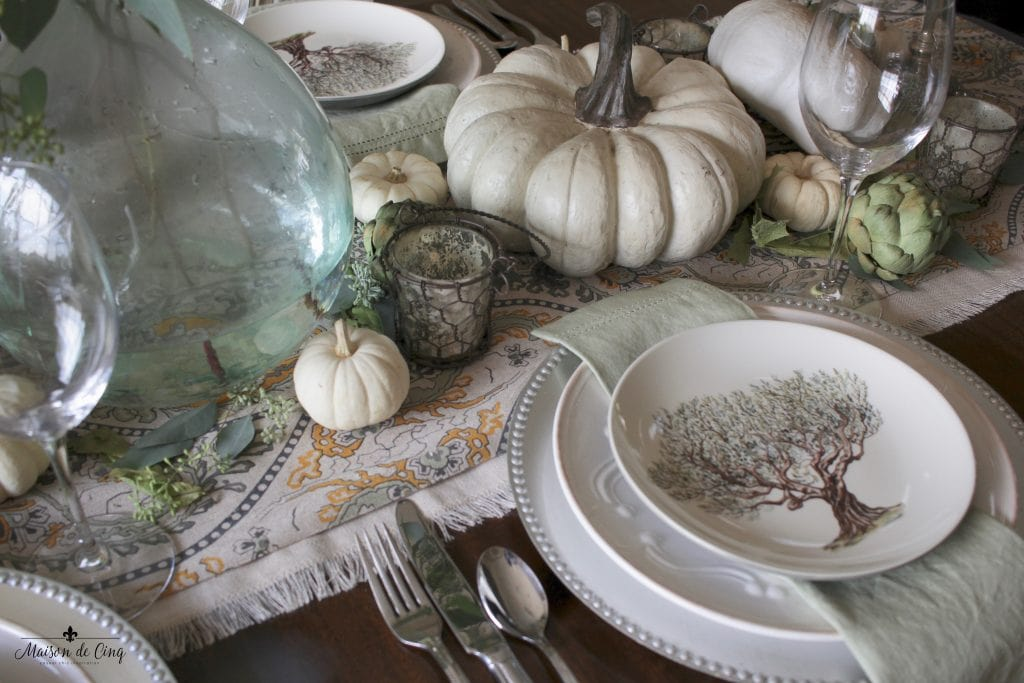 elegant fall tablescape natural elements with white pumpkins and eucalyptus