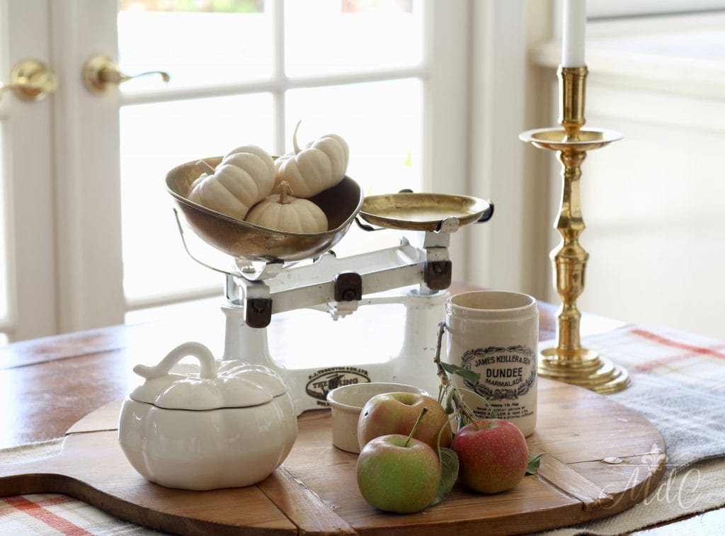 warm and cozy fall home tour kitchen tablescape vignette pumpkins apples