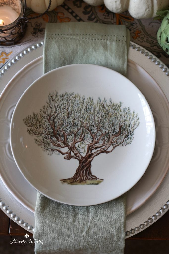 elegant fall tablescape green linen napkin salad plate with tree silver charger