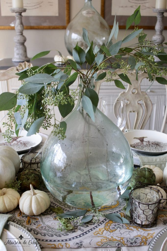 elegant fall tablescape demijohn with eucalyptus and natural elements