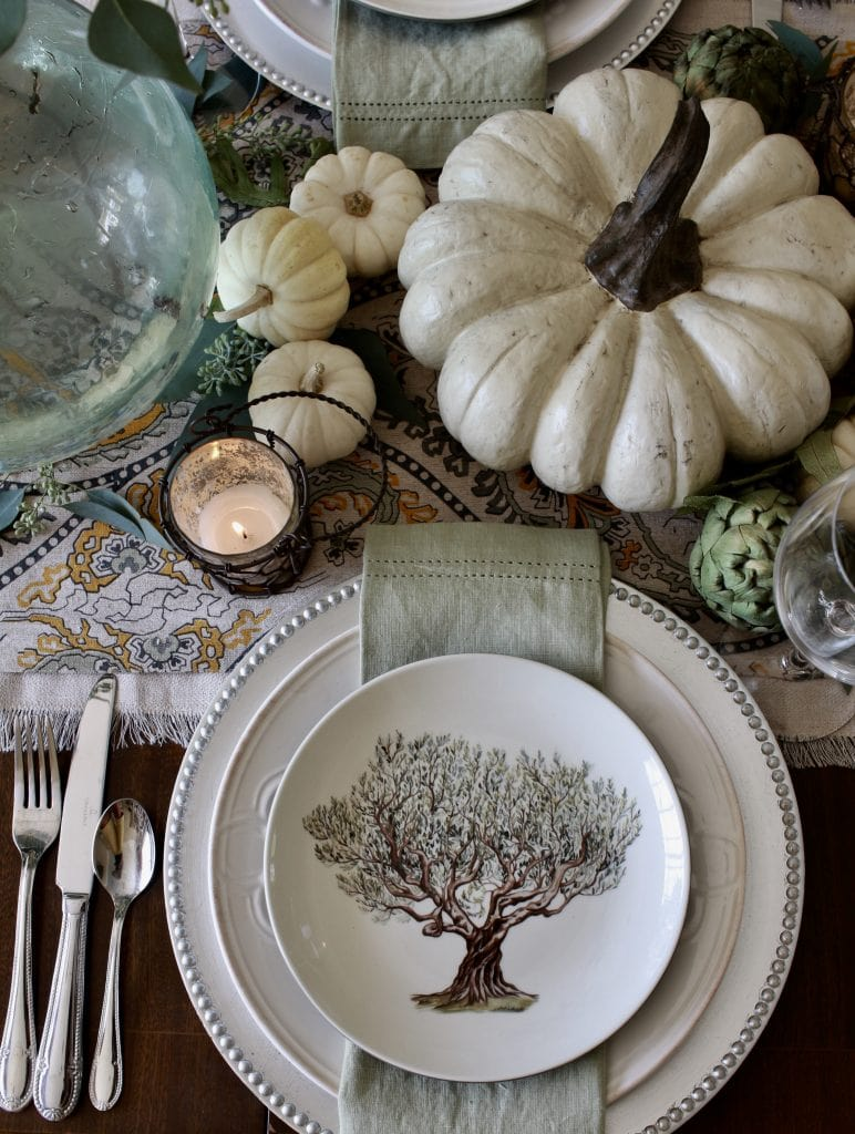 elegant fall tablescape with white pumpkins and greens
