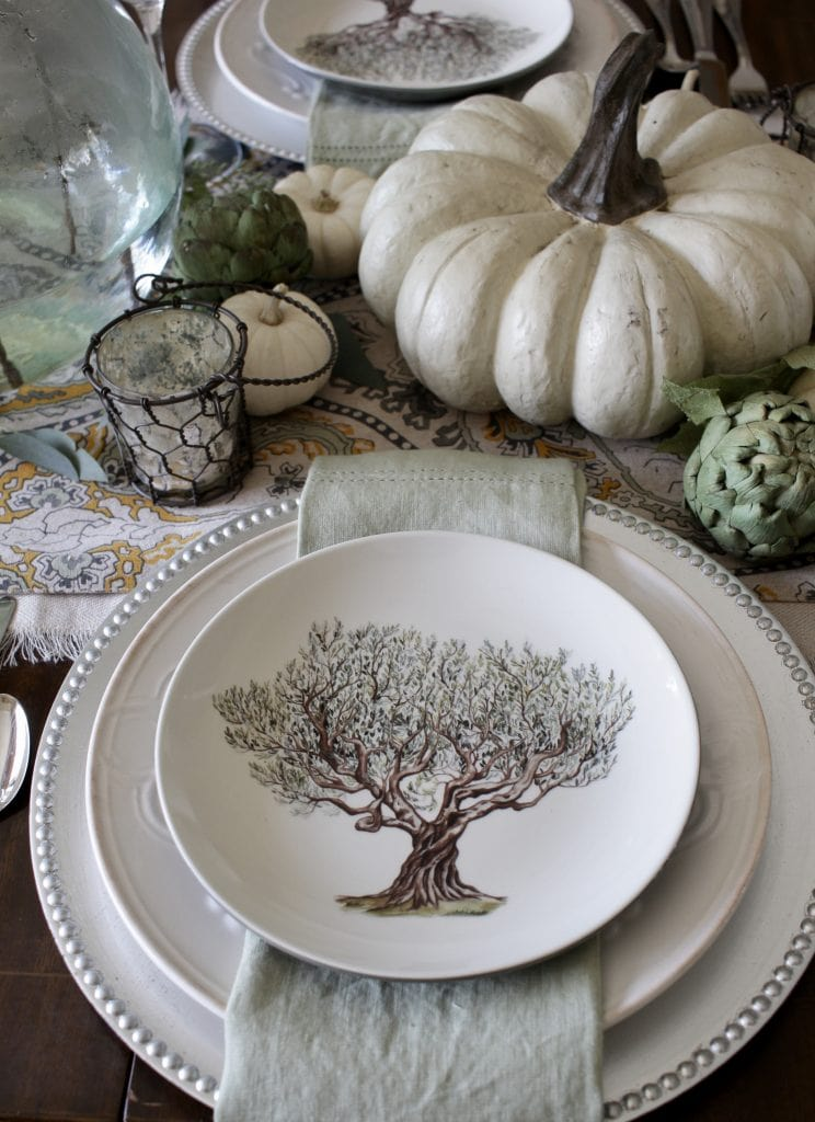 elegant fall tablescape with williams sonoma plates white pumpkins and artichokes 3