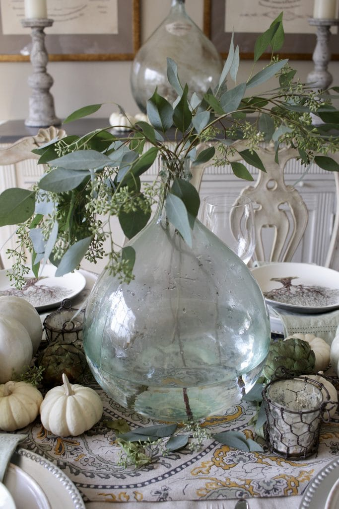elegant fall tablescape with demijohn with eucalyptus