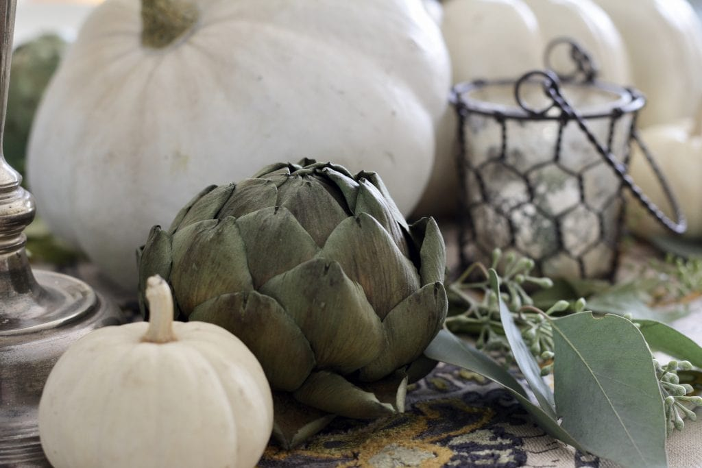 elegant fall tablescape with white pumpkins and artichokes