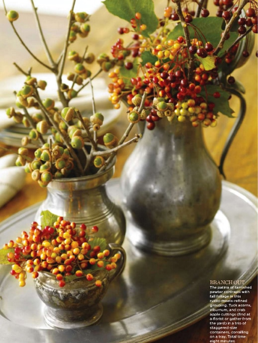 decorating with pewter pitchers berries greens charming display