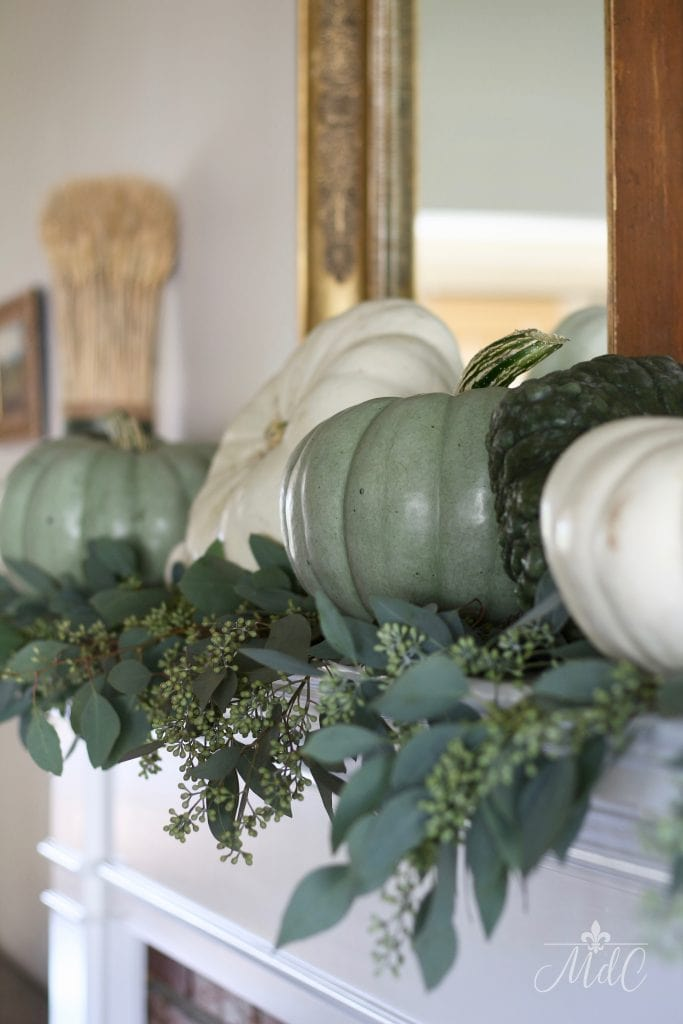 neutral fall mantel green and white pumpkins eucalyptus autumn decor