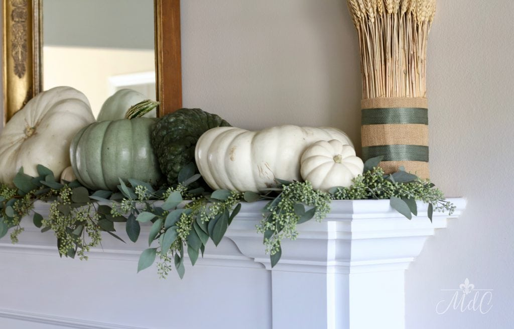 neutral fall mantel autumn decor green and white pumpkins
