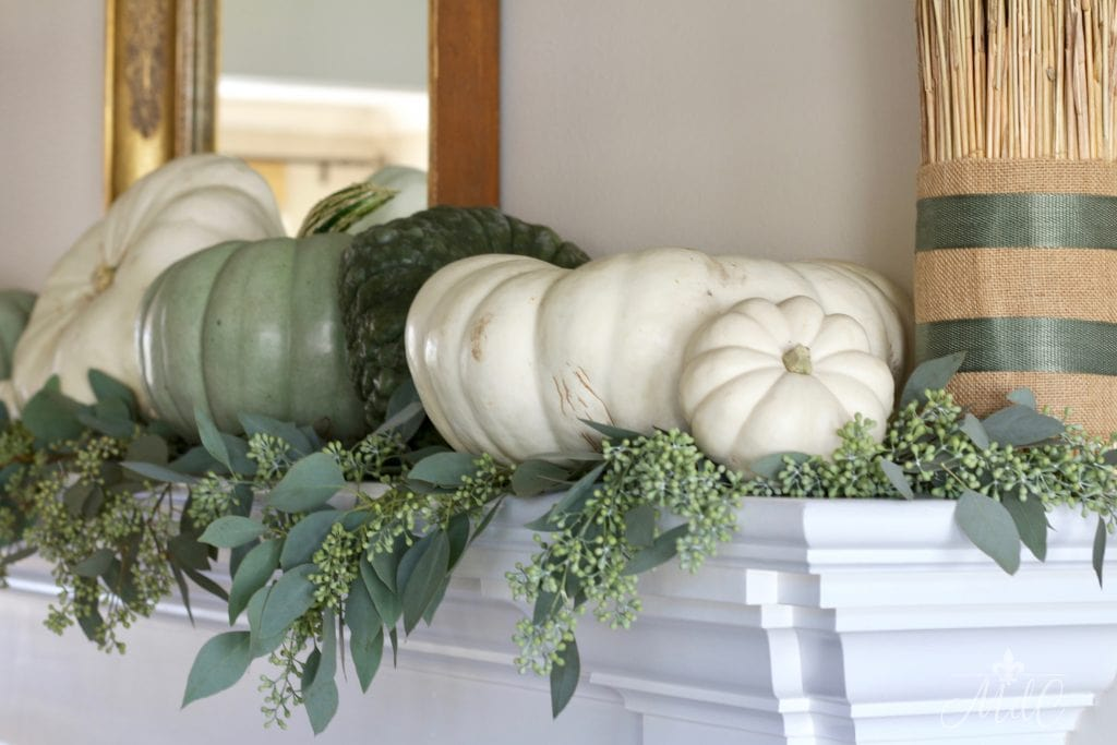 neutral fall mantel using natural elements greens pumpkins wheat