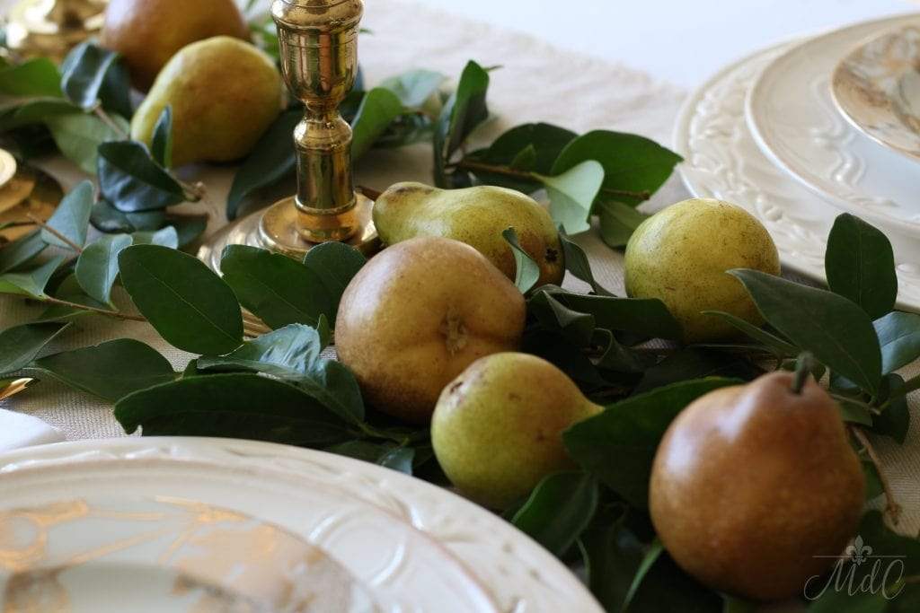 thanksgiving table with pears and greens