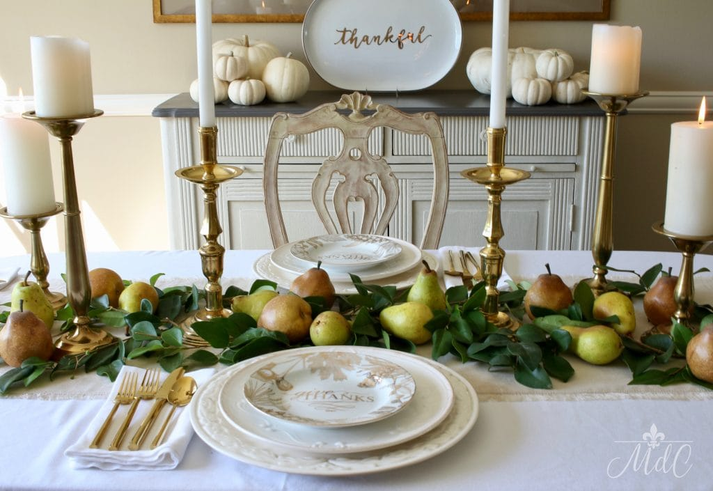 thanksgiving table gold candleholders pears and greens