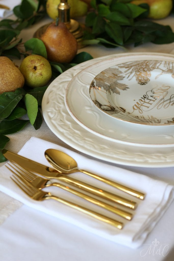thanksgiving table in gold and white with pears and greens 2