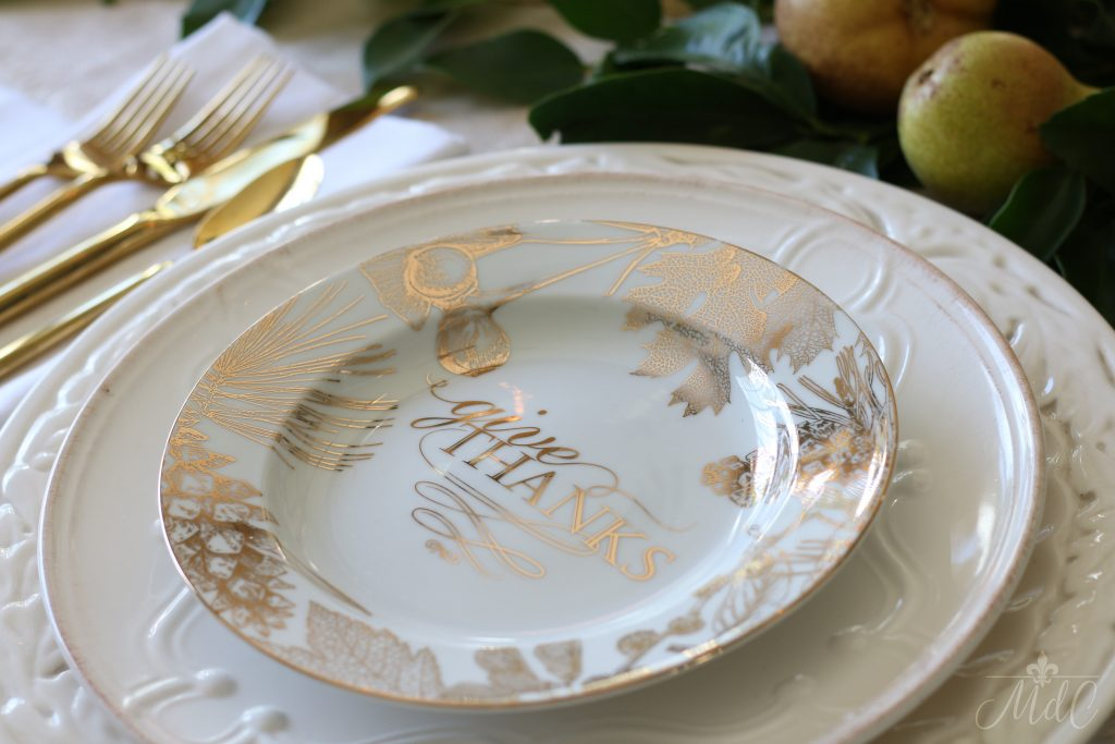thanksgiving table white plates layered and gold flatware