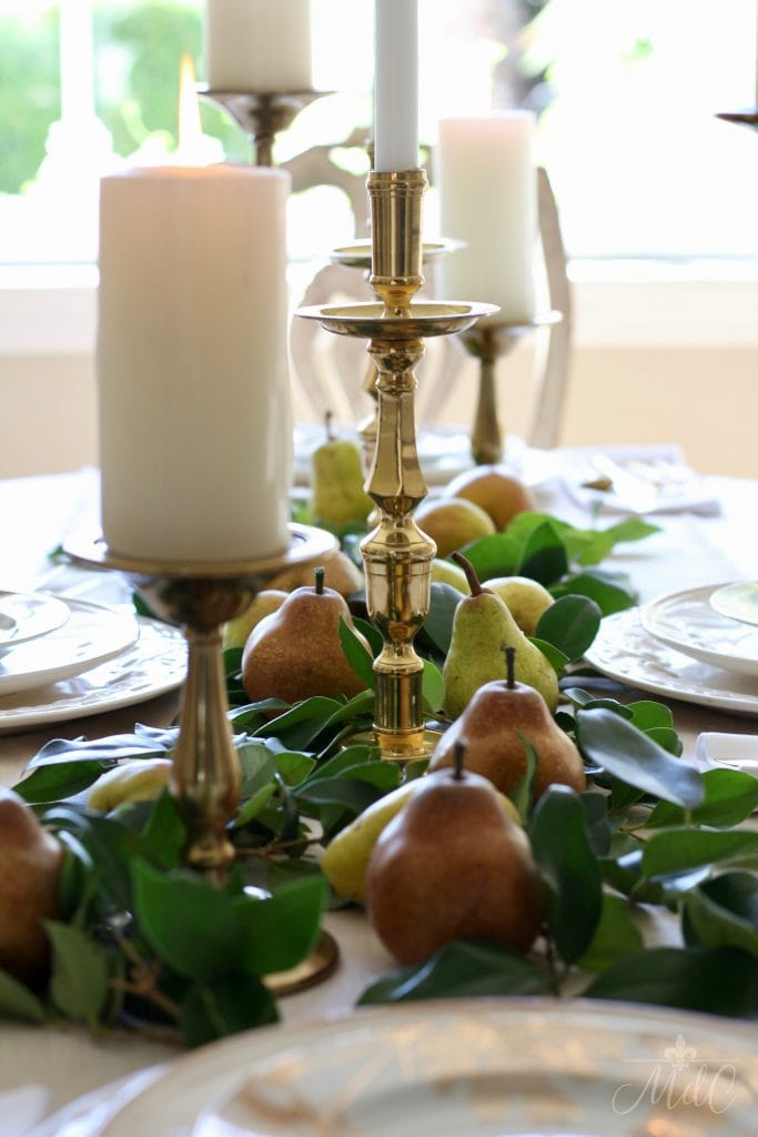 thanksgiving table gold and brass candleholders greens and pears
