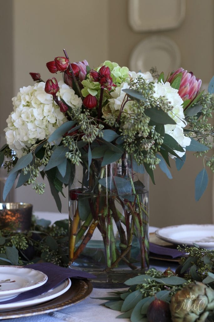 thanksgiving table floral arrangement hydrangeas red flowers eucalyptus rich colors of fall