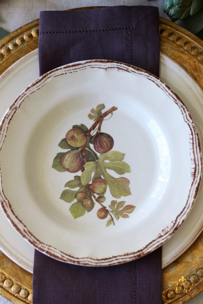 thanksgiving table figs plates with deep plum napkins and gold chargers 2