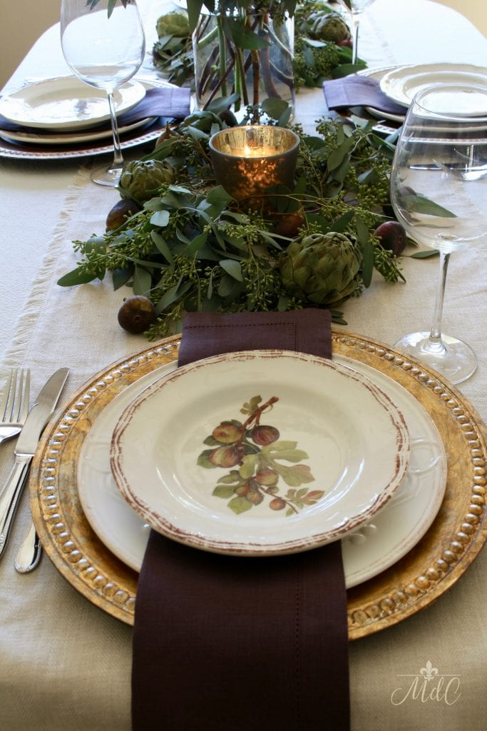 thanksgiving table fig plates with runner of eucalyptus figs and artichokes