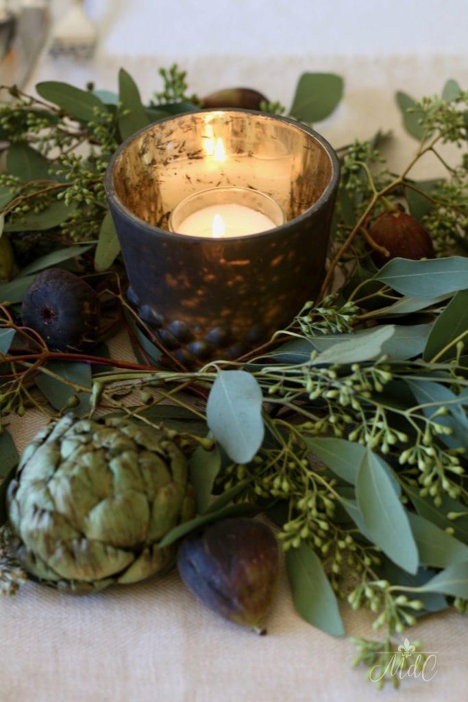 thanksgiving table mercury votives figs artichokes and eucalyptus