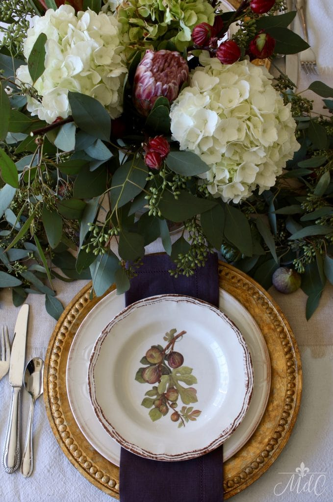 thanksgiving table figs plates and gold chargers with hydrangeas and eucalyptus