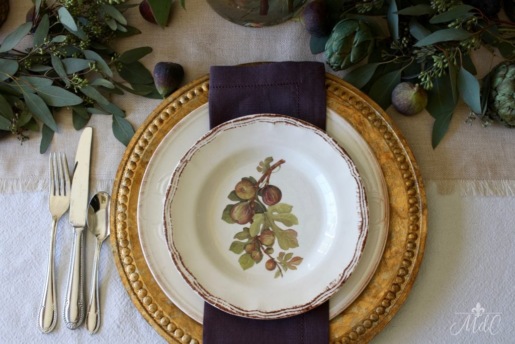 thanksgiving table gold chargers fig plates deep plum napkins