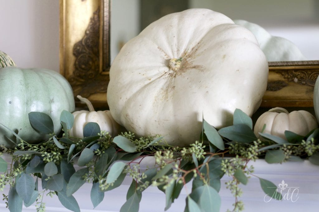 stunning neutral fall mantel with eucalyptus and white pumpkins