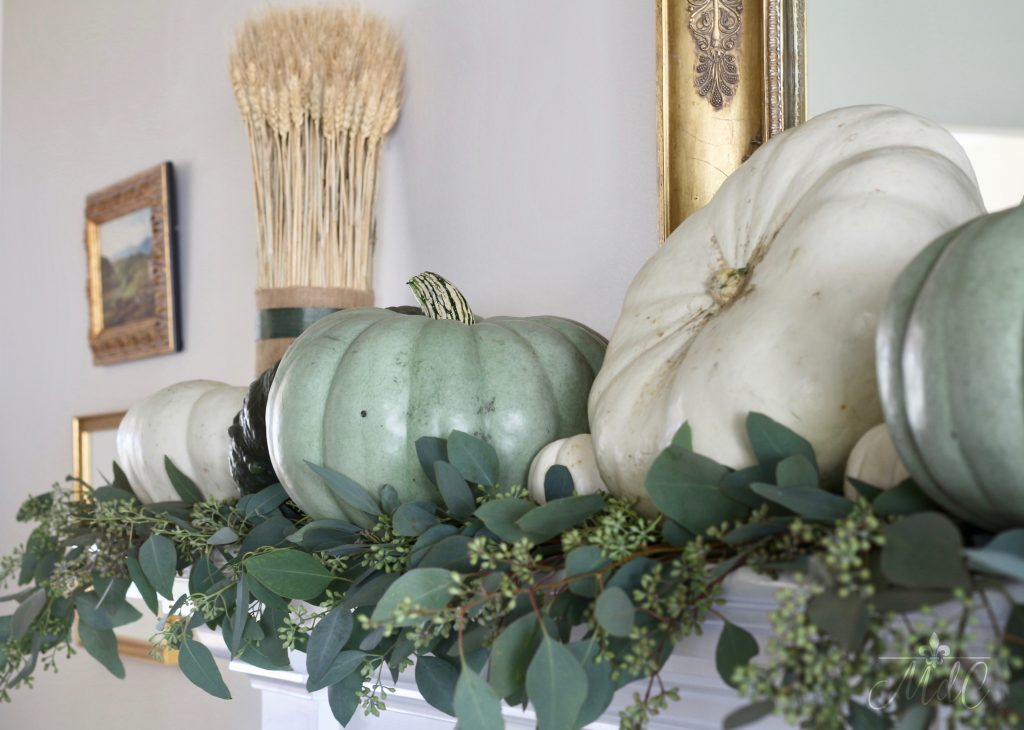 gorgeous neutral fall mantel with white and green pumpkins