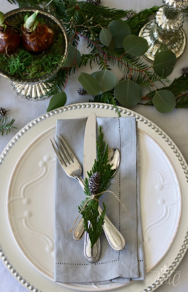 christmas tablescape paperwhites grey napkins greenery pinecones