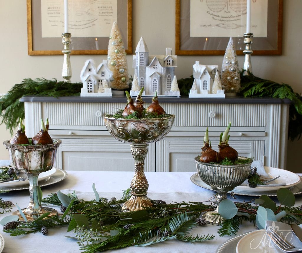 christmas tablescape paperwhites mercury glass bowls greens white houses christmas trees