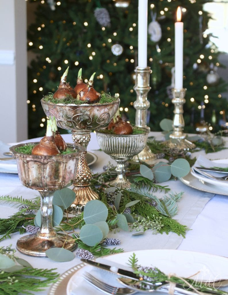 christmas tablescape paperwhites mercury glass candlesticks greenery