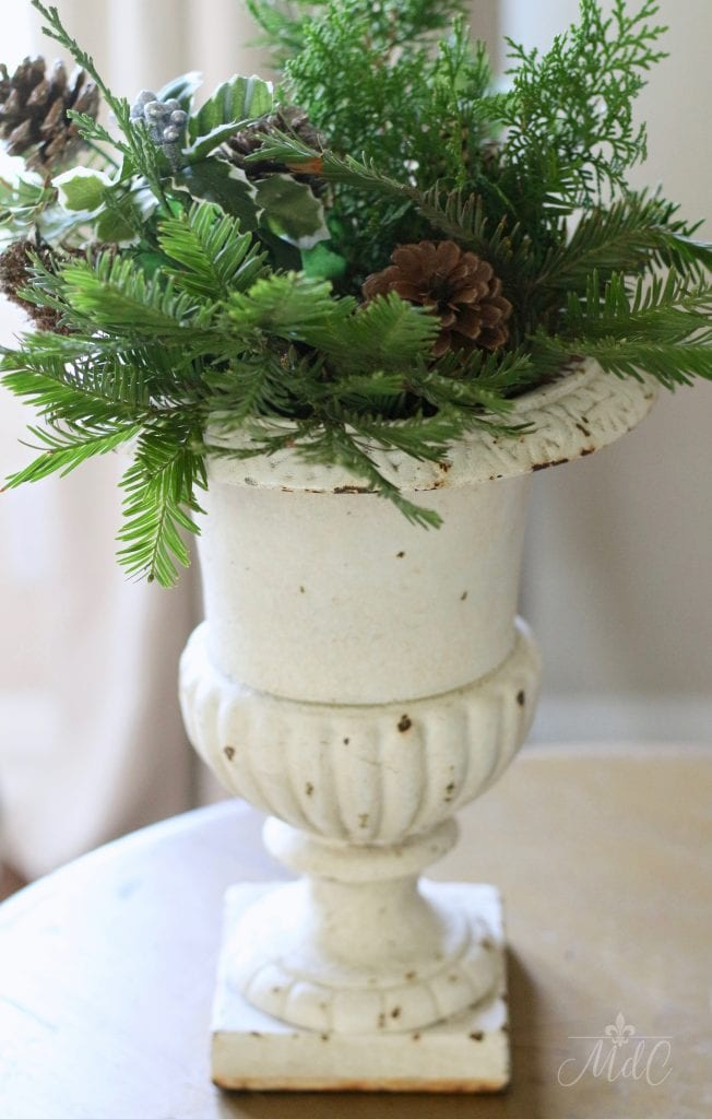 french christmas tour antique french urn pine clippings greens pine cones