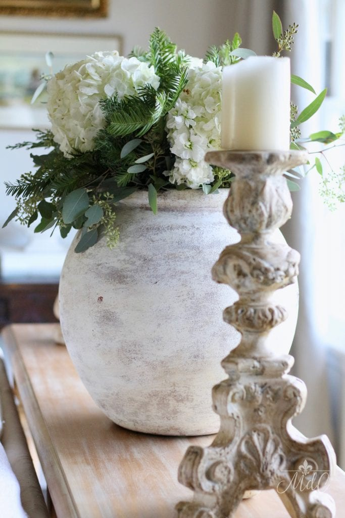 french christmas tour large antique stone vase hydrangeas and antique candleholder