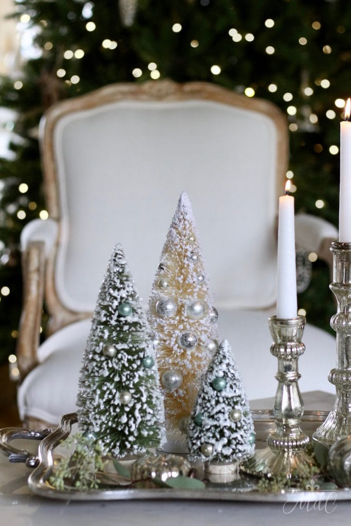 french christmas tour white french chair bottle brush trees decor candlesticks