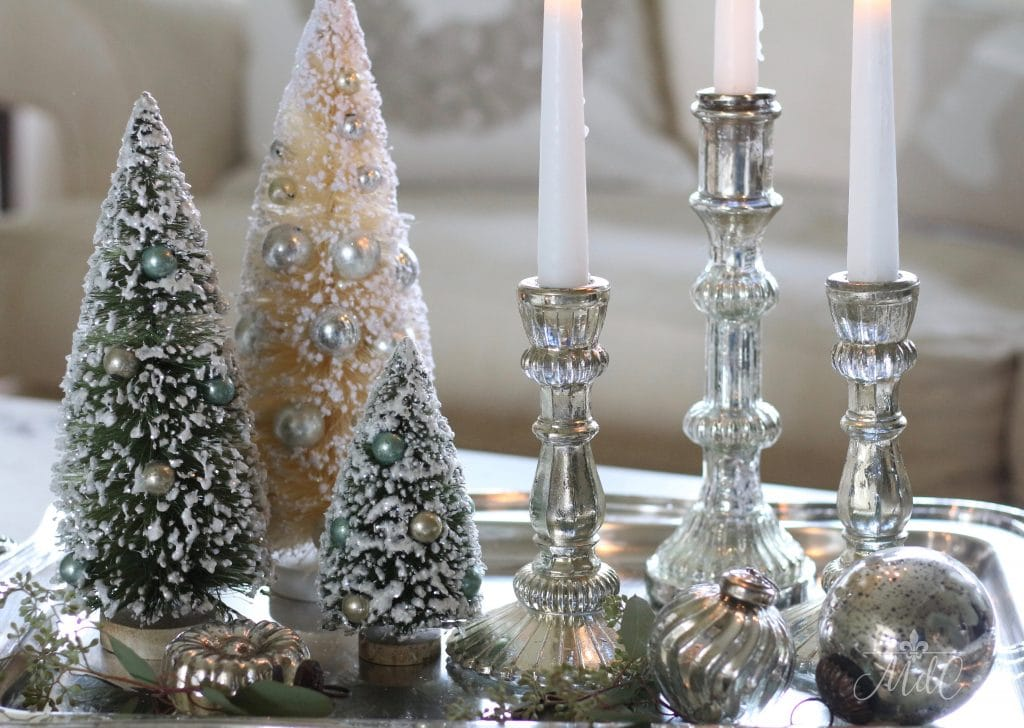 french christmas tour bottle brush trees silver mercury candlesticks on silver tray christmas inspiration