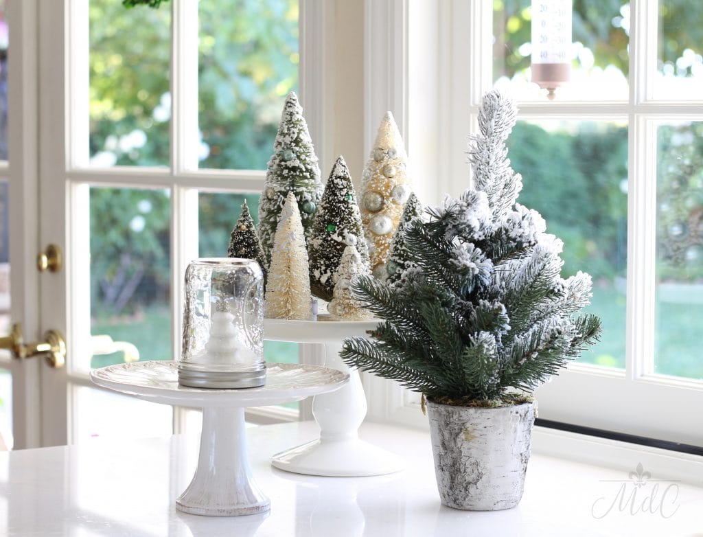 christmas kitchen holiday vignette bottle brush trees pine tree cake stands white kitchen